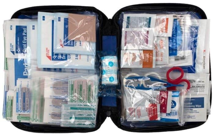 Black First Aid kit filled with supplies