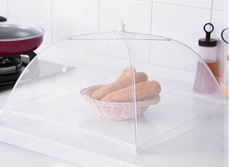 White Net pop up food cover over bowl of bread