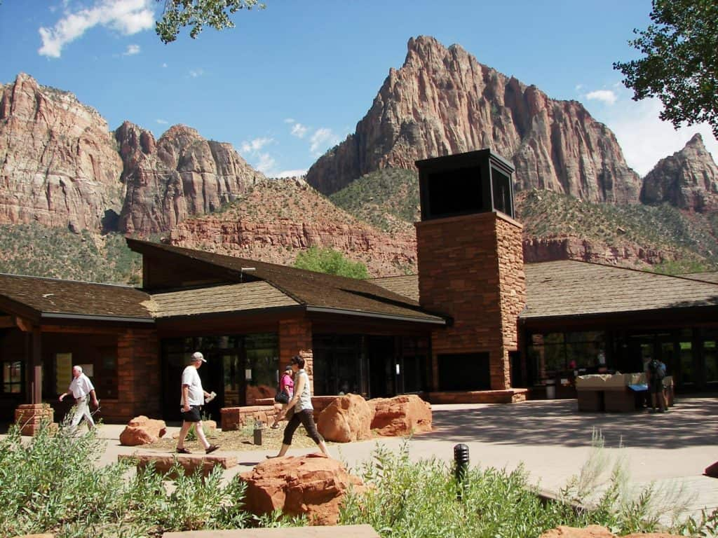 Zion Canyon Visitor Center with people walking