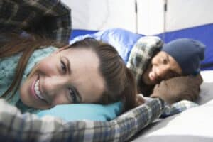 Couple sleeping on camping pillows in tent