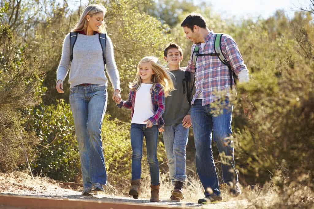 Family Hiking with Children in the Woods