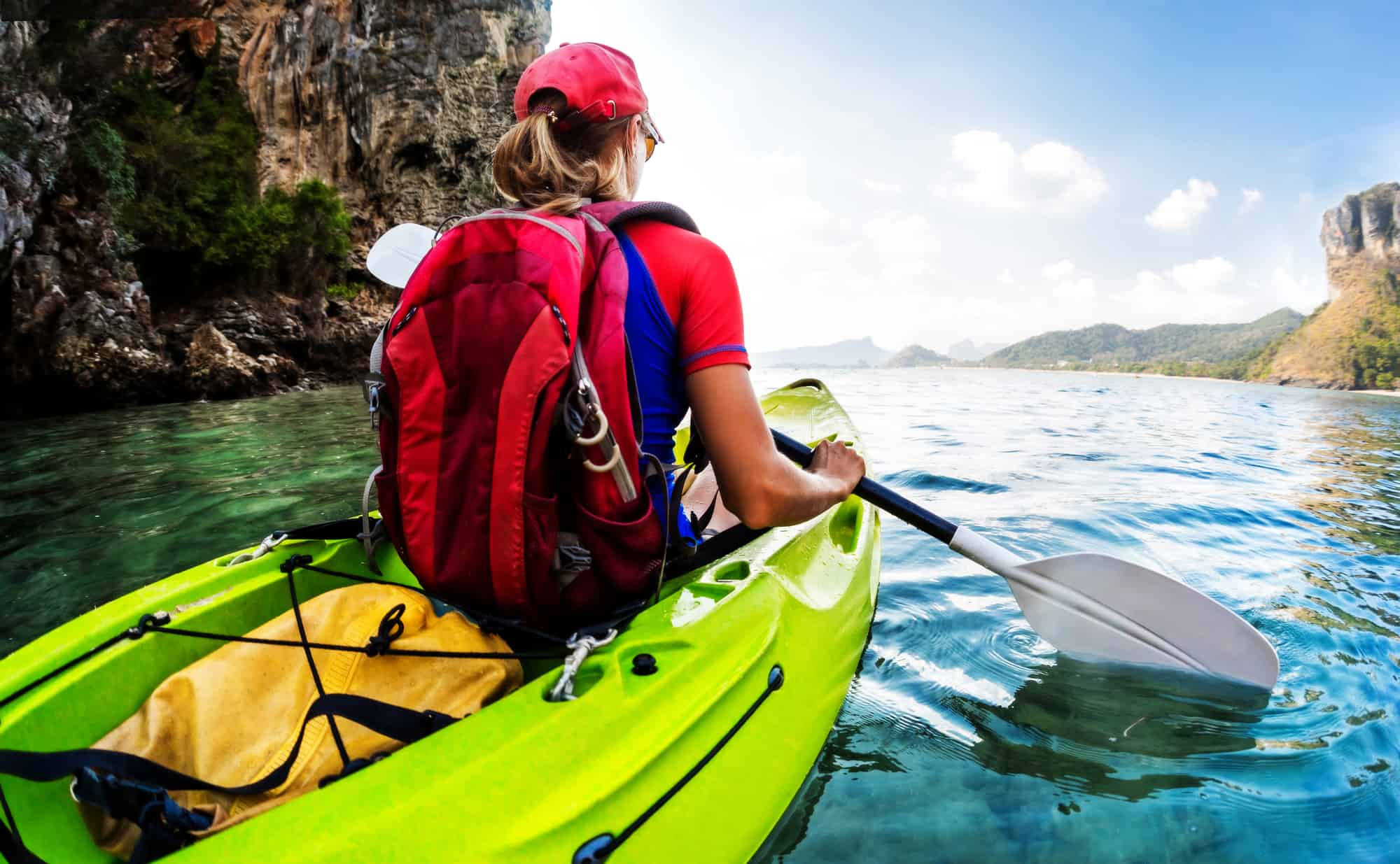 How to Waterproof a Backpack by putting it into a dry sack in a kayak