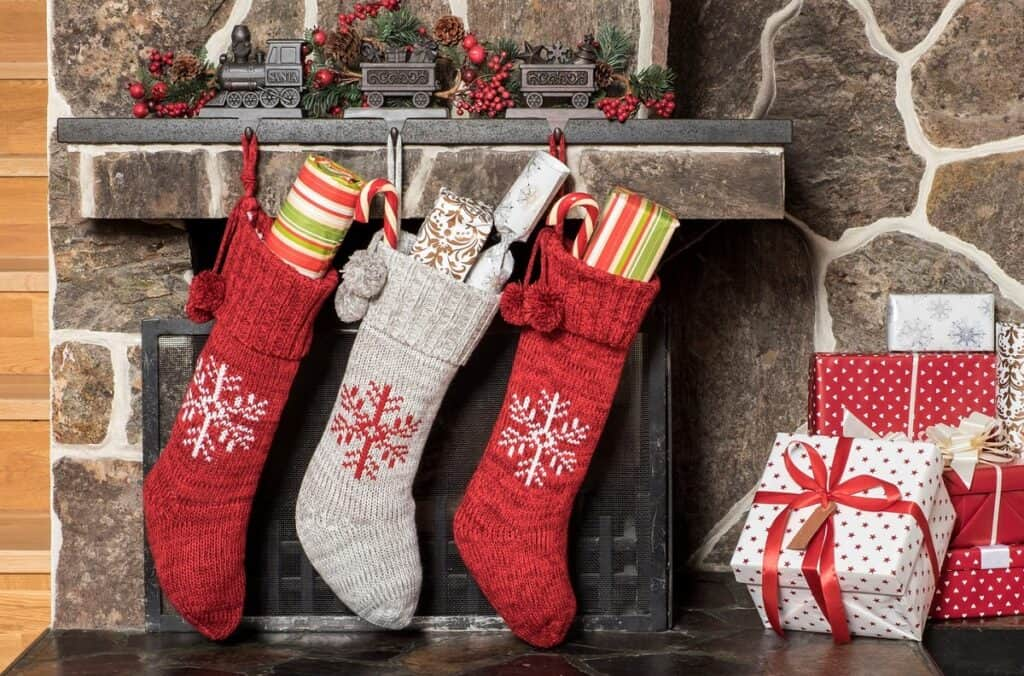 Stocking Stuffers for hikers hanging on fireplace